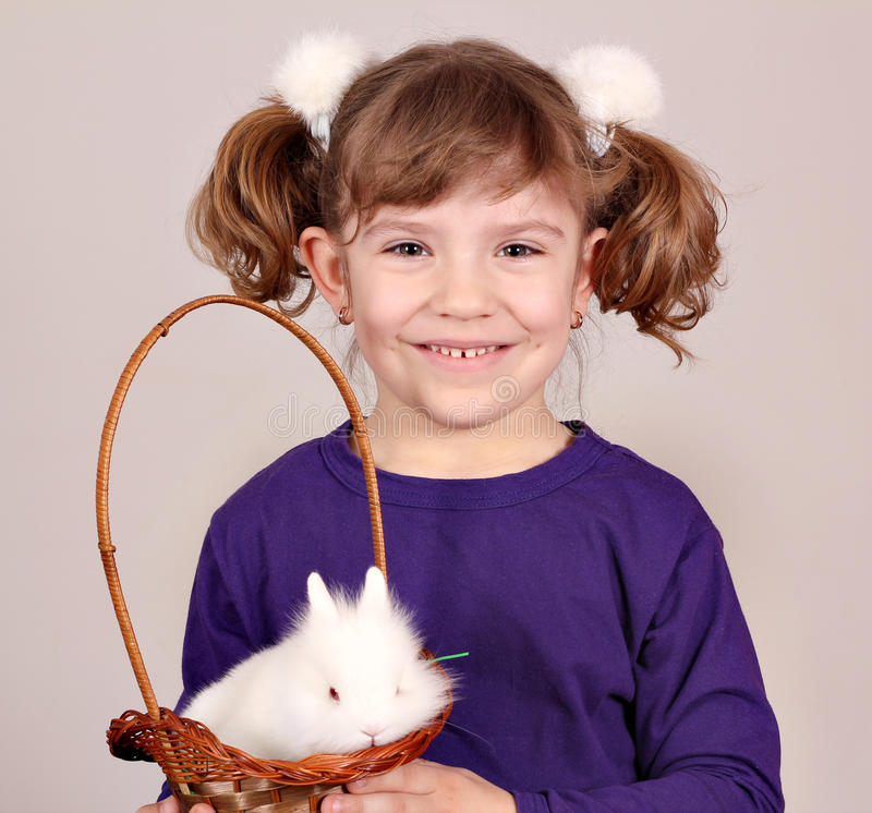Little girl and white dwarf bunny pet. Beautiful little girl and white dwarf bunny pet royalty free stock photo