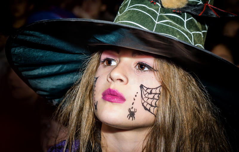 Beautiful little girl in a witch costume for maskenball royalty free stock photo
