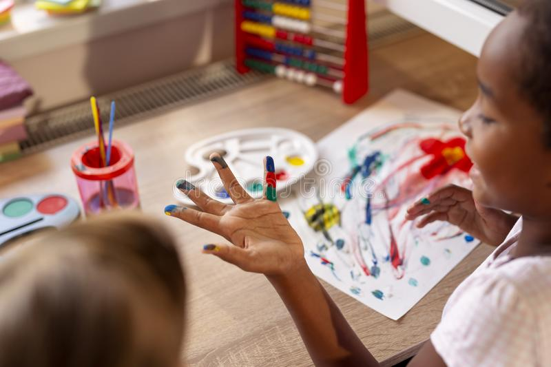 Little girls painting stock photography