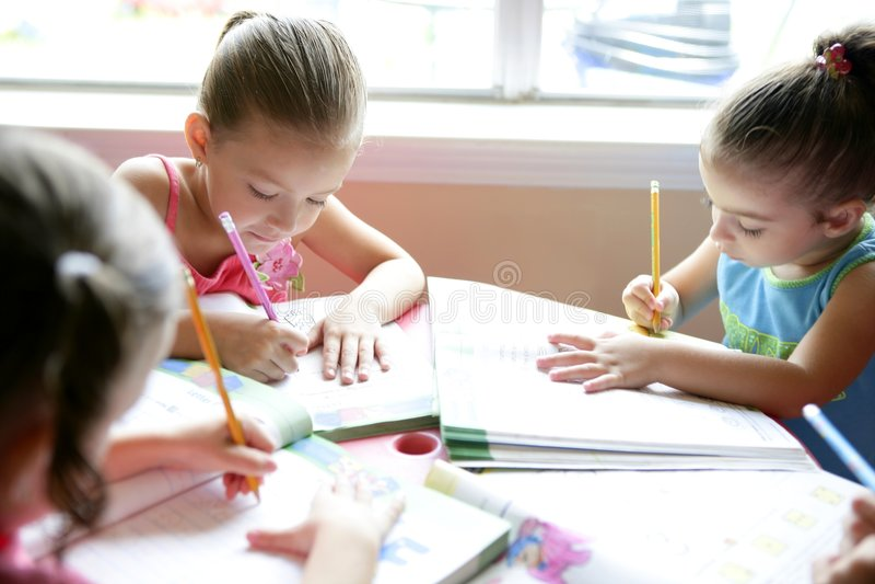Beautiful little girls, homework at home stock photography