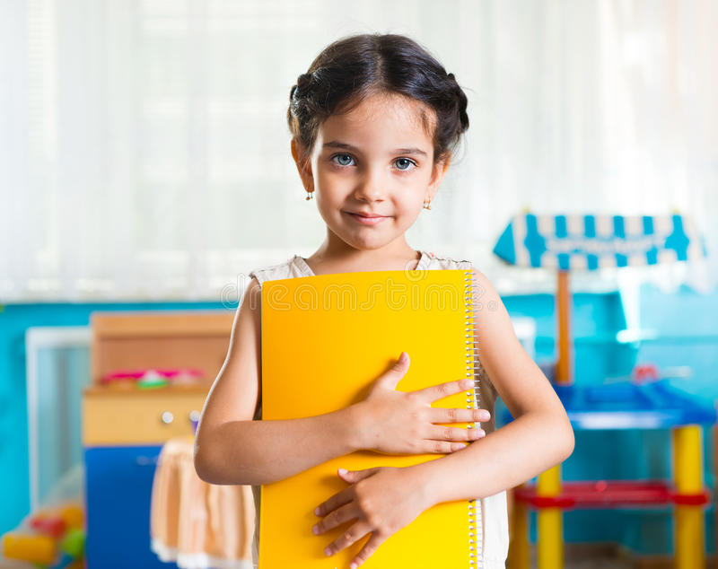Beautiful little latin girl portrait in daycare stock photo