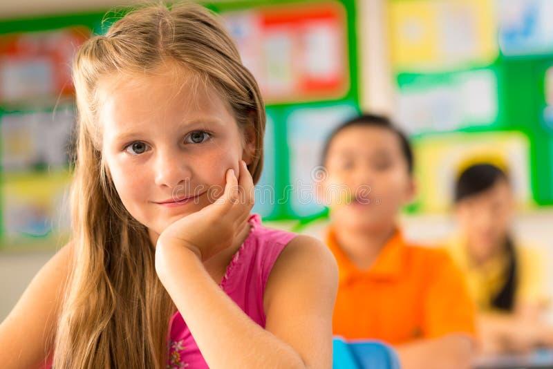 Beautiful little schoolgirl royalty free stock image