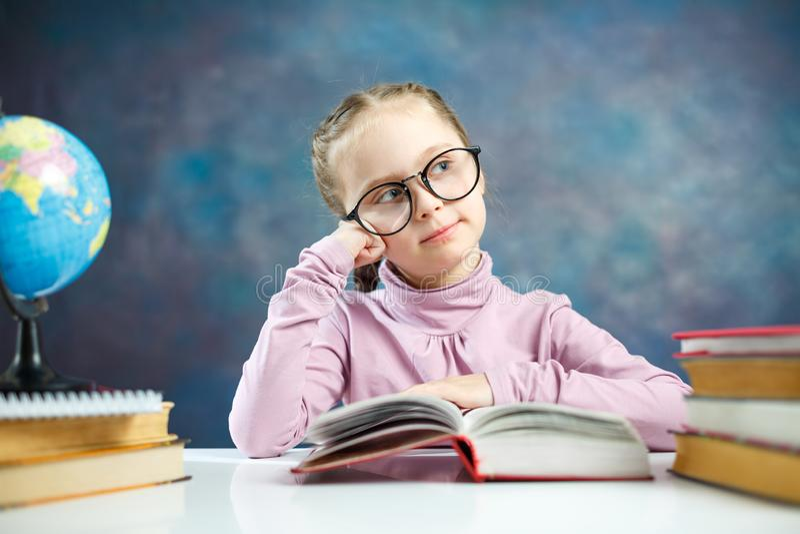 Beautiful Little Schoolgirl Read Book Thoughtfully stock photography