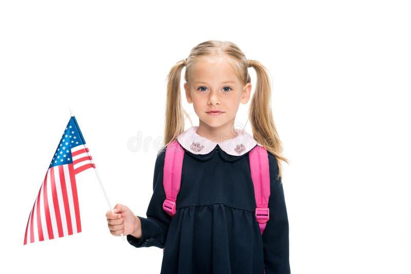 Little schoolgirl with usa flag. Beautiful little schoolgirl with usa flag isolated on white stock photos