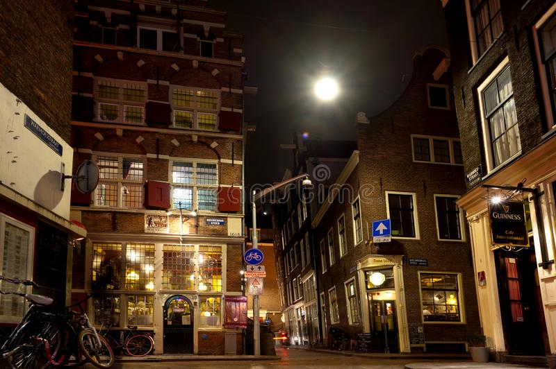 Beautiful little traditional houses in Amsterdam by night. March 12th, 2012. Amsterda stock images