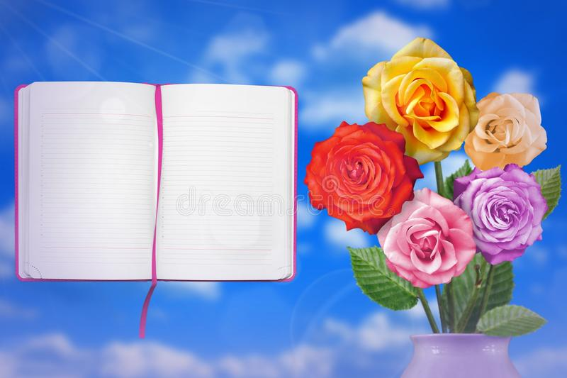 Beautiful live rose bouquet bouquet in porcelain vase with opened note book with blank place for your information on left on cloud stock illustration