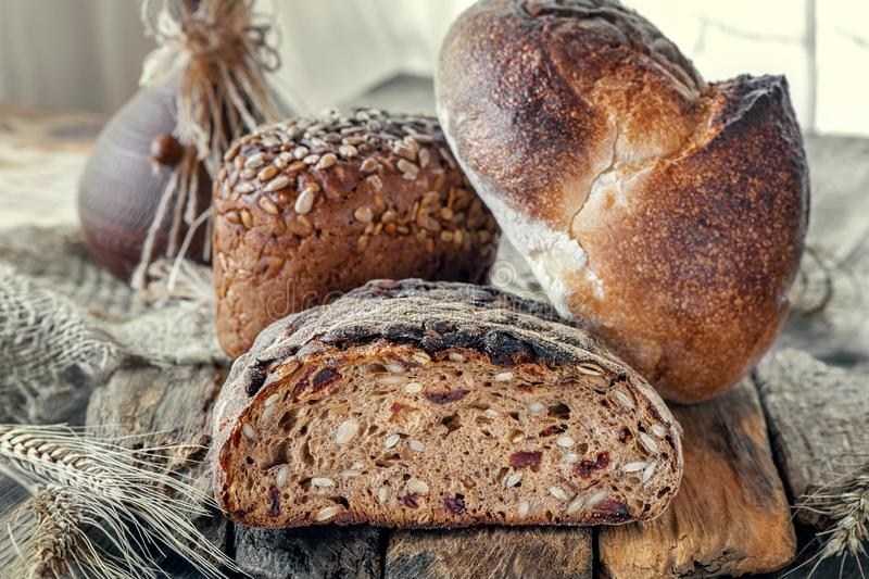 Beautiful loaves of bread on a leaven of white wheat on a plate on the edge of the canvas. Homemade cakes, handmade. Close up stock photo
