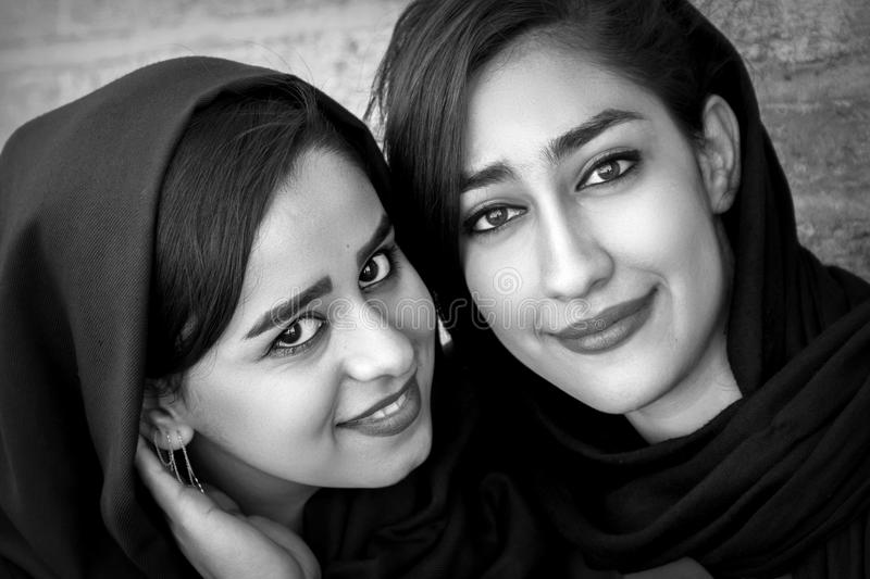 Beautiful local girls smiling at the old bridge in Esfahan. Black and white photo. royalty free stock photo