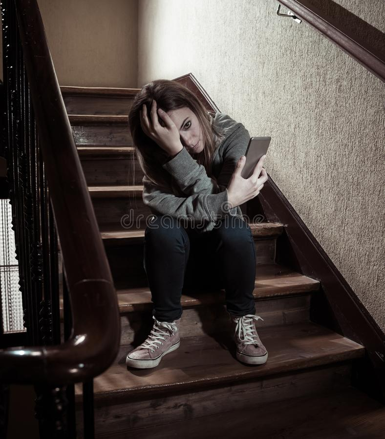 Beautiful lonely young girl depressed and worried suffering from bullying and harassment at school stock photo