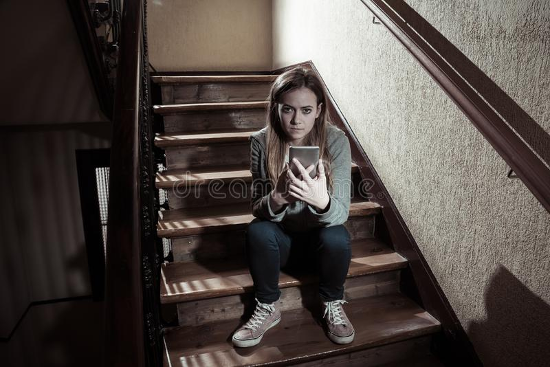 Beautiful lonely young girl depressed and worried suffering from bullying and harassment at school stock images
