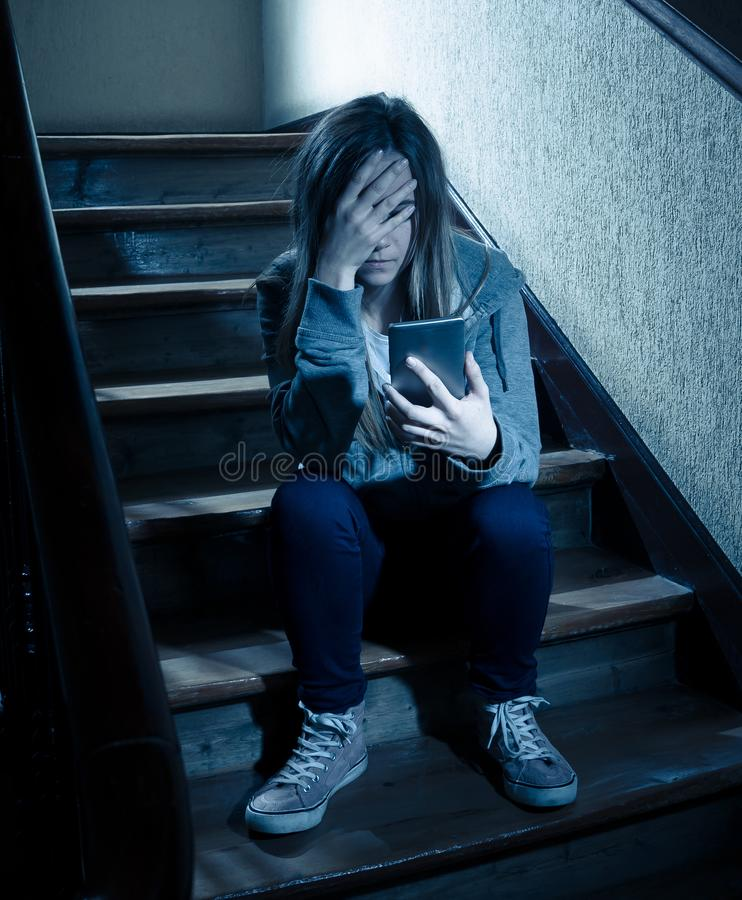 Beautiful lonely young girl depressed and worried suffering from bullying and harassment at school royalty free stock image