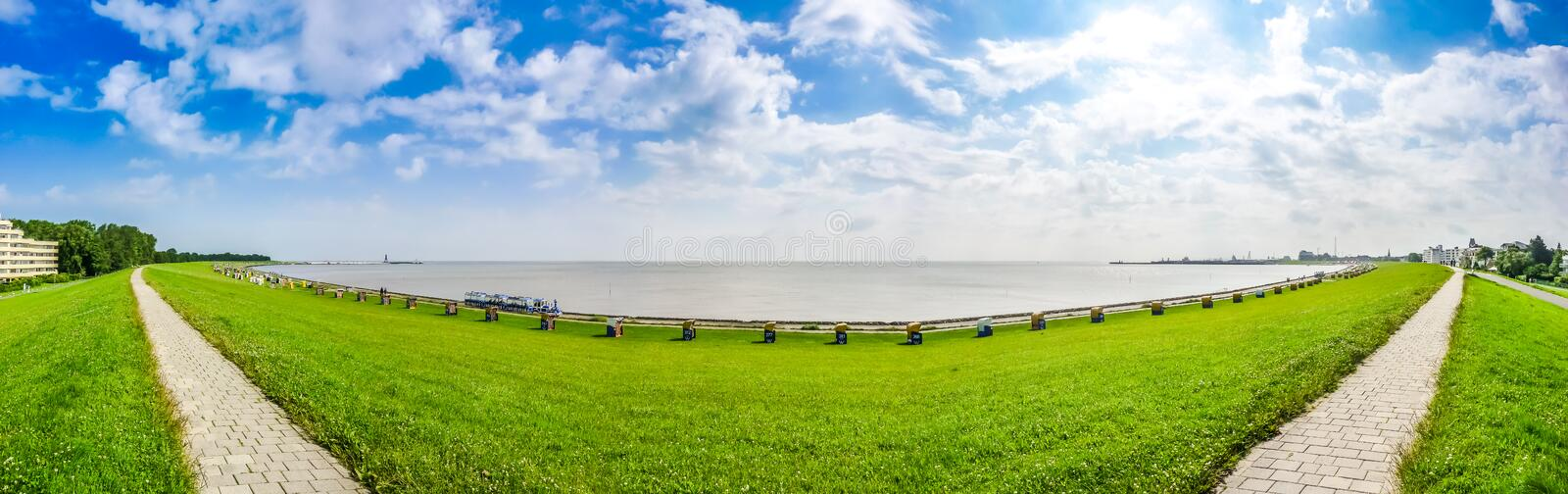 Beautiful long beach with typical northsea beachchairs in Cuxhaven, Germany stock images