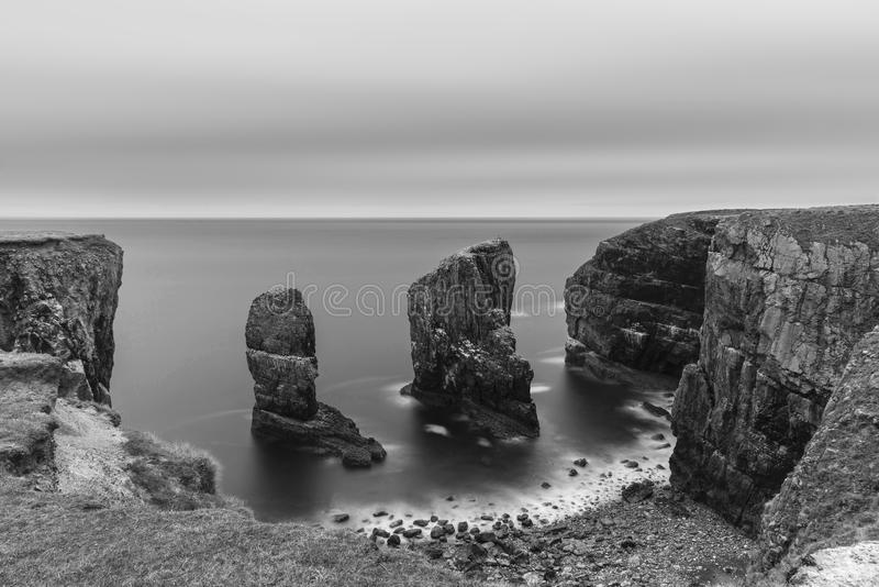 Beautiful long exposure black and white sunset landscape image o stock photos
