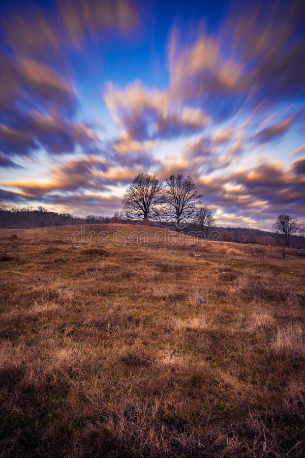 Beautiful long exposure scene with dramatic clouds and dry trees stock images