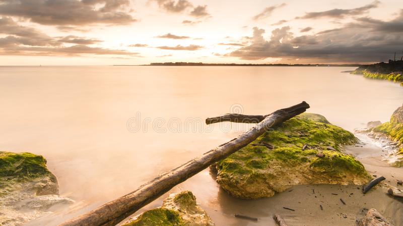 BEAUTIFUL LONG EXPOSURE LANDSCAPE OF SEA AND GREEN ROCKS royalty free stock photos