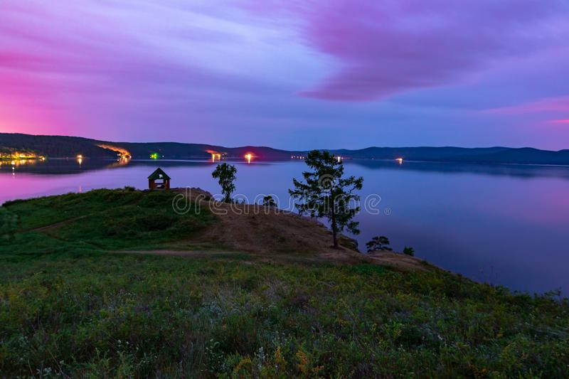 Beautiful long exposure landscape view of the mountain lake Turgoyak, Russia. With purple sky and summer house on the hill in summer night, sunrise, evening stock photos