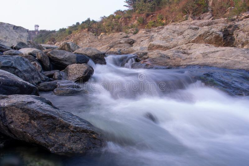 Beautiful long exposure stock image of water flowing down the hill. In India stock photos