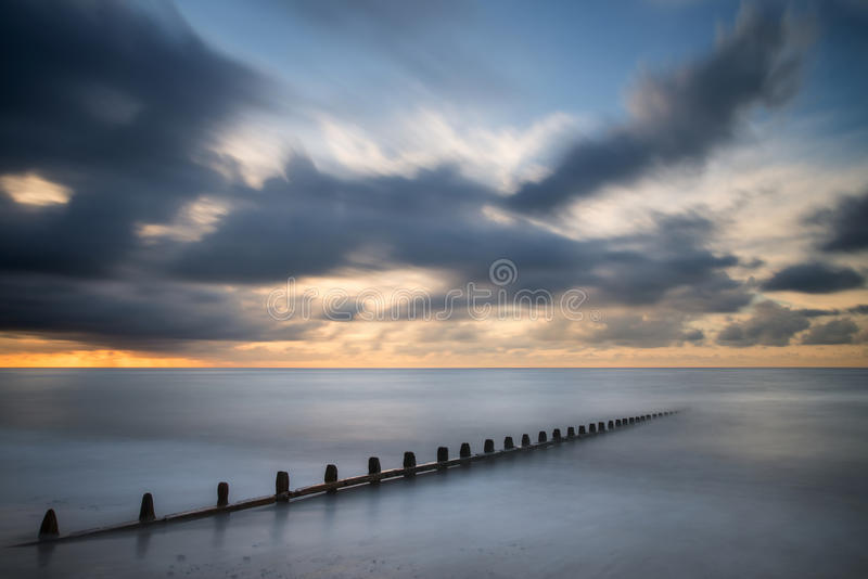 Beautiful long exposure vibrant concept image of ocean at sunset royalty free stock photo