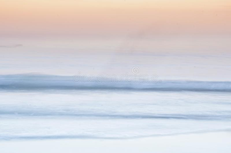 Beautiful of Long exposure with waves and clouds and using camera panning motion combined with a long exposure. Beautiful of Long exposure with waves and clouds royalty free stock photo