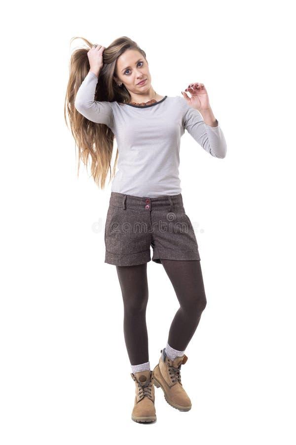 Beautiful long hair cute candid woman holding hair walking royalty free stock photos