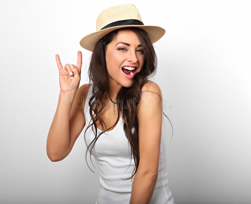 Beautiful long hair excited woman showing fingers the rock cool stock images