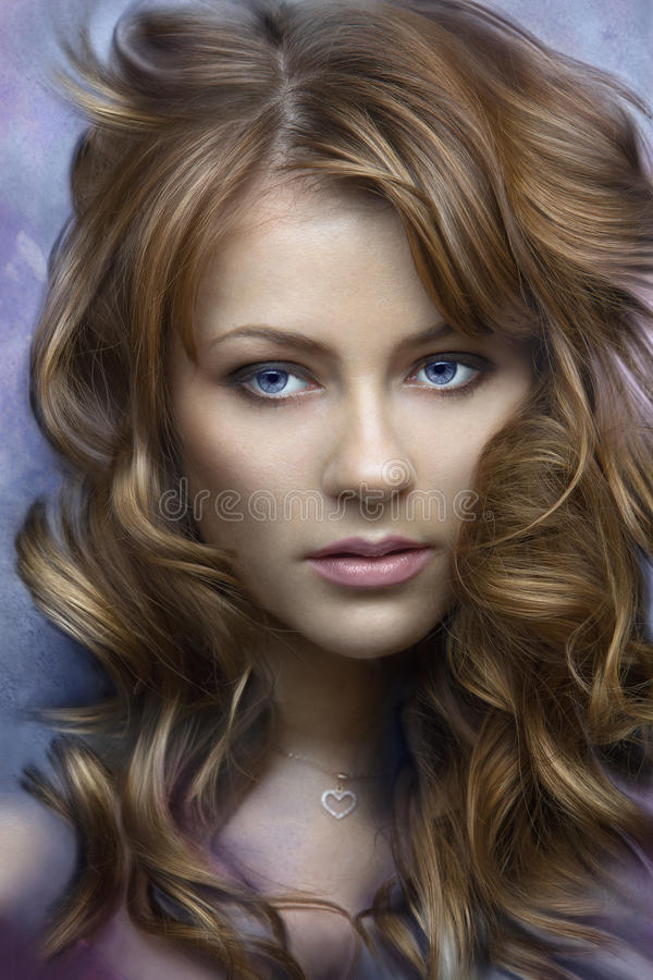 A beautiful long-haired girl stock photo