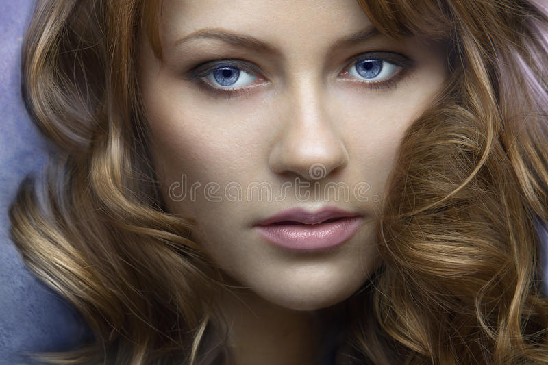 A beautiful long-haired girl stock images