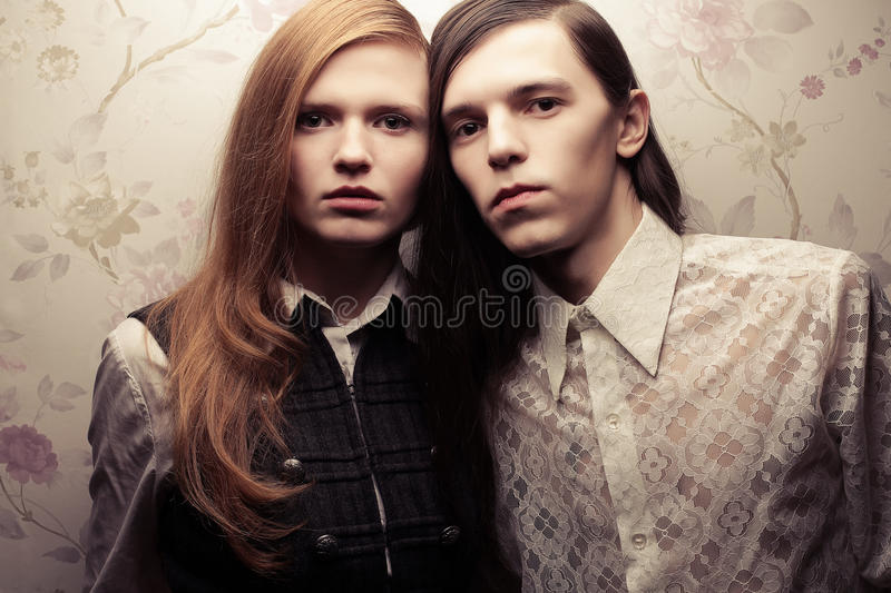 Beautiful long haired people in vintage style stock image