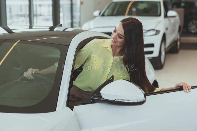 Beautiful businesswoman buying new automobile royalty free stock photography