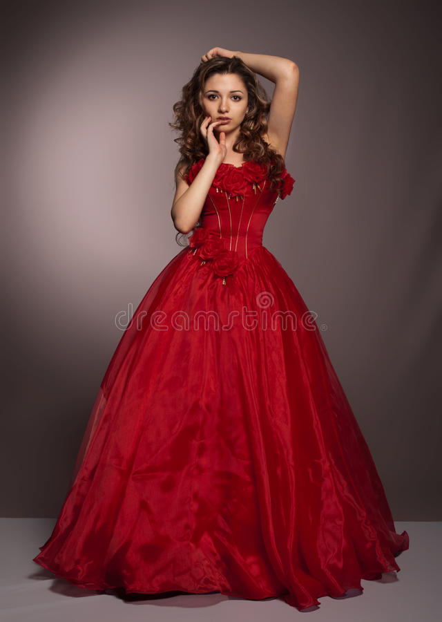 Beautiful long haired woman in red dress stock image