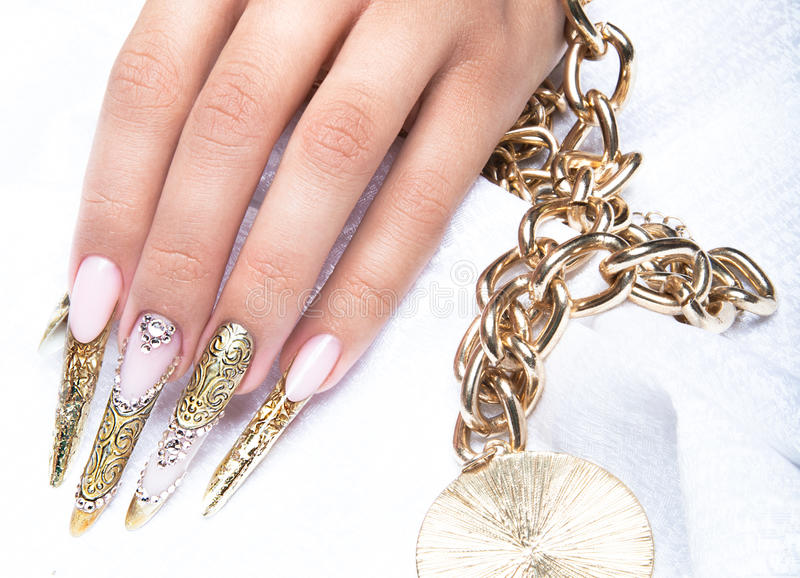 Beautiful Long Nails In A Gold Design With Stock Image - Image of ...