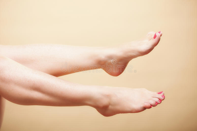 Beautiful Long Naked Woman Girl Legs On Orange Royalty Free Stock Images