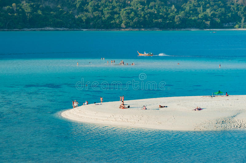 Beautiful long shot of sand dune white sandy beach and blue calm stock photography
