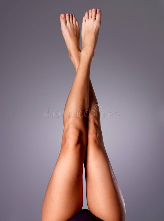 Beautiful long slender female legs after depilation stock photos