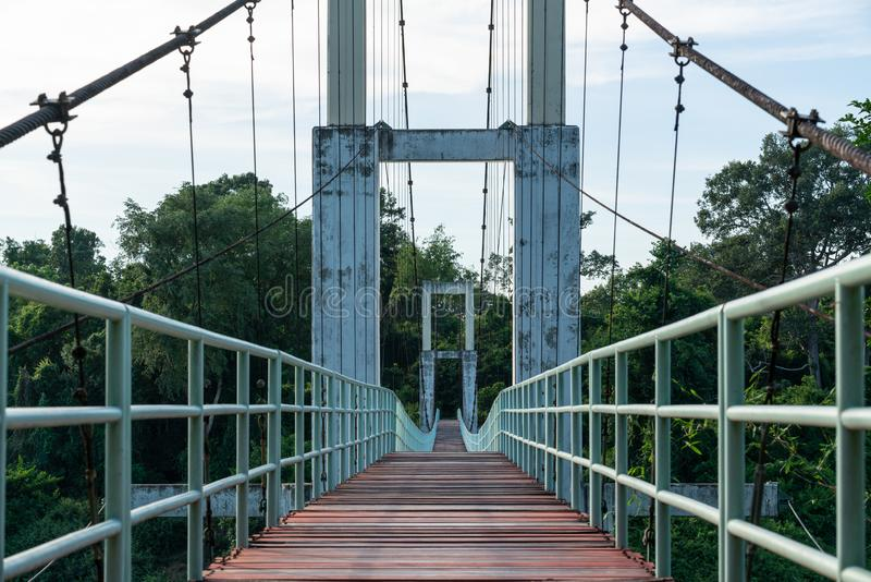 Beautiful of the longest suspension bridge in North eastern Region at Tana Rapids National Park,Ubonratchatani, Thailand.  royalty free stock photography