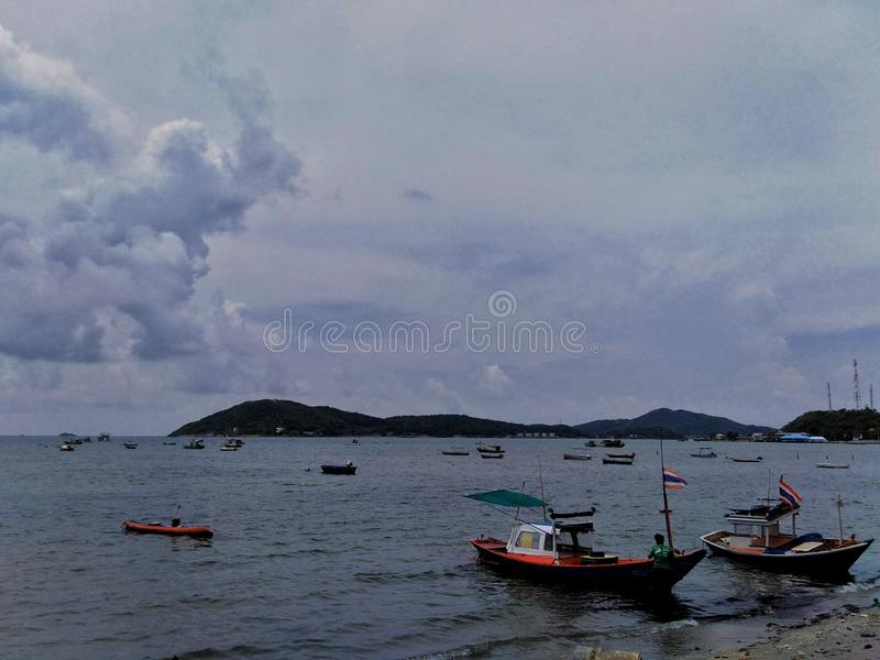 Beautiful lotus flowers in the poolFishing boats and beautiful views in the sea royalty free stock photography