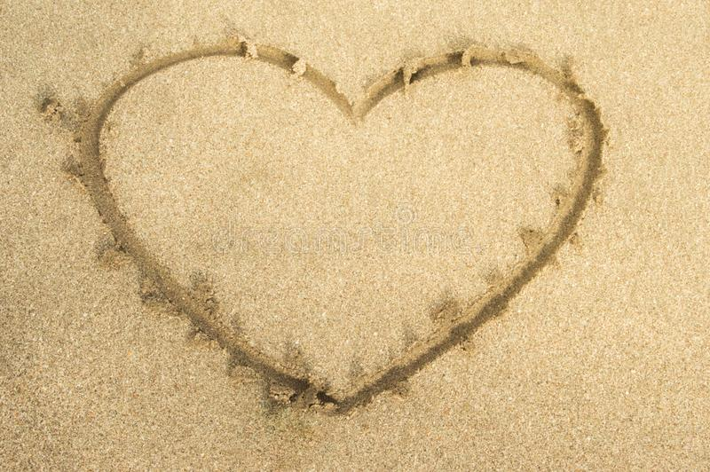 Love heart drawing on beach sand royalty free stock photo