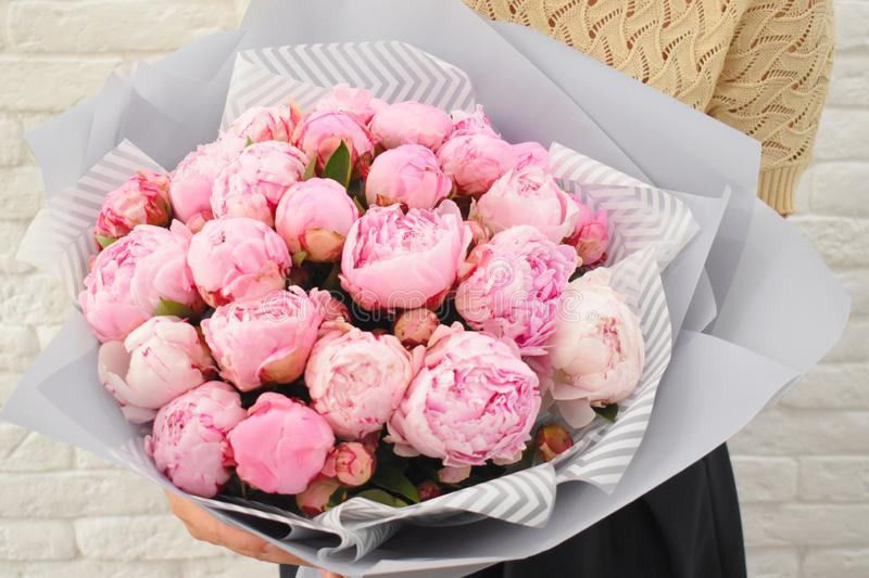 Beautiful love pink peonies in stylish floristic packing royalty free stock photos