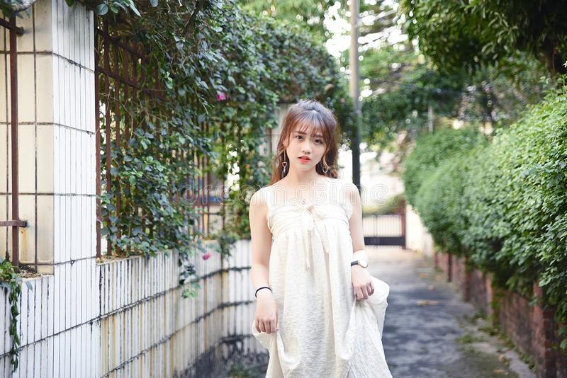 Beautiful and lovely Asian girl shows her youth in the park royalty free stock image