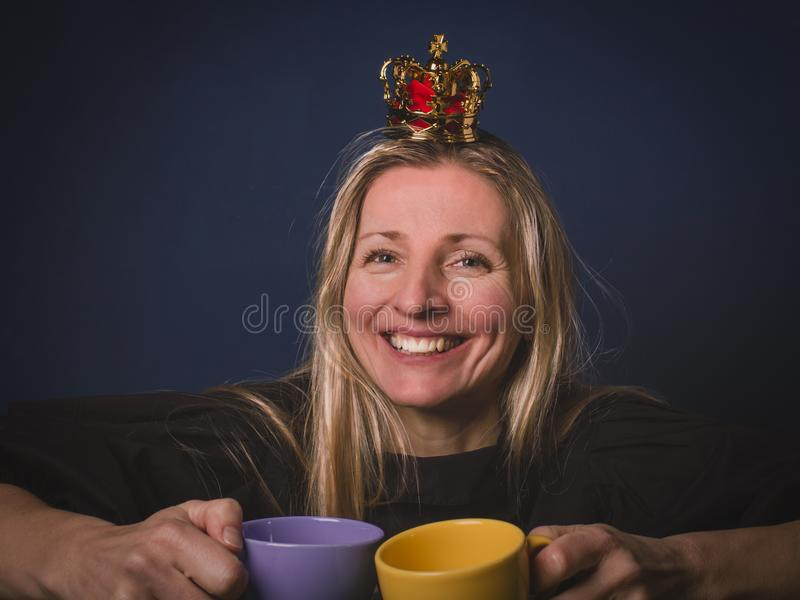 Beautiful lovely expression woman in crown keeps in her hands t royalty free stock image