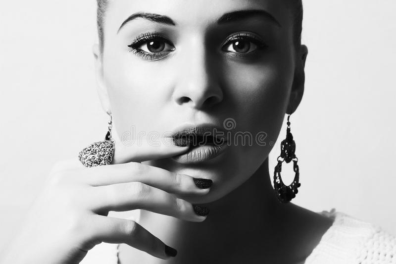 Beautiful Lovely Woman with Jewelry. Tender Beauty Girl Accessories. Manicure. Black and white royalty free stock images