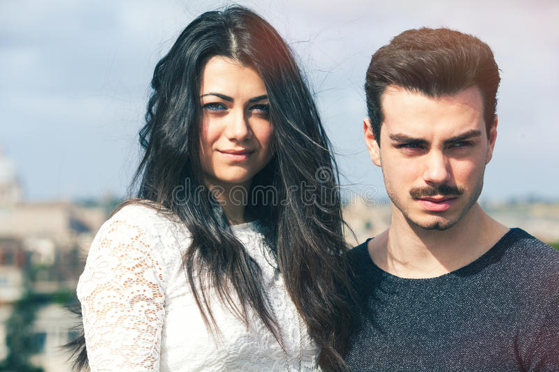 Beautiful lovely young italian couple outdoors royalty free stock photo