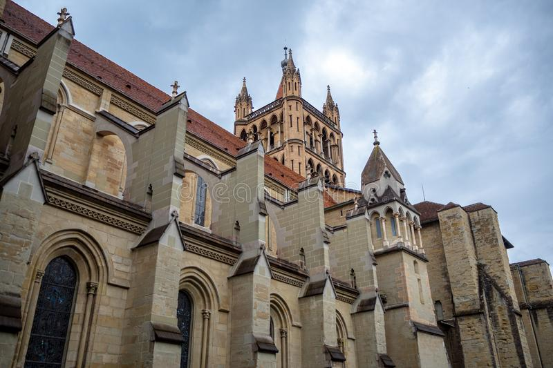 Beautiful low angle view of Laussanne cathedral on clouds sky background royalty free stock photography