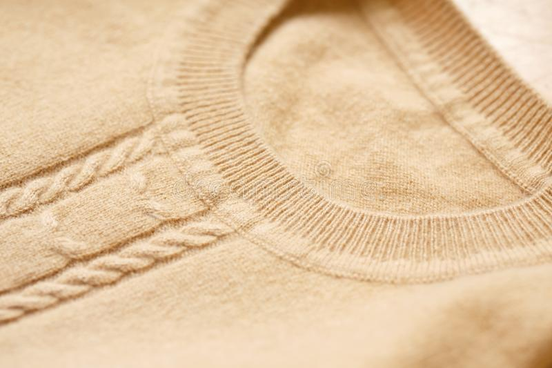 Beautiful, luxurious, knitted sweater in beige, autumn, winter, warm. stock images