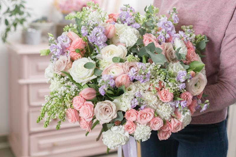 Beautiful luxury bouquet of mixed flowers in woman hand. the work of the florist at a flower shop. stock images