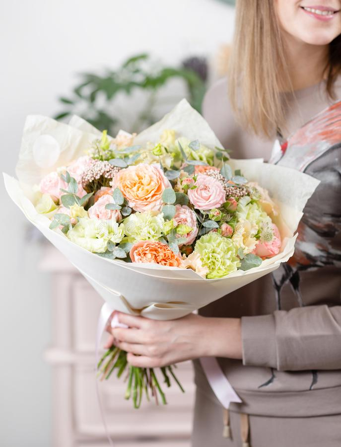 Beautiful luxury bouquet of mixed flowers in woman hand. the work of the florist at a flower shop. Wedding stock photo