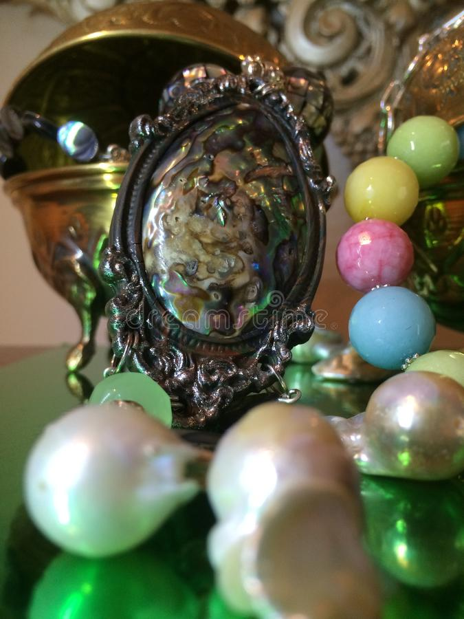 Beautiful Luxury Jewellery Display of Loose Nucleated Kasumi Pearls, Candy Jade Artisan Necklace & Handcrafted Abalone Necklace. royalty free stock images