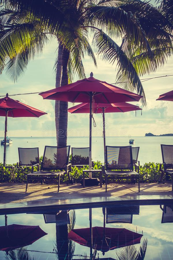 Beautiful luxury outdoor swimming pool in hotel and resort. Beautiful luxury outdoor swimming pool with umbrella and chair in hotel and resort for travel and royalty free stock photography