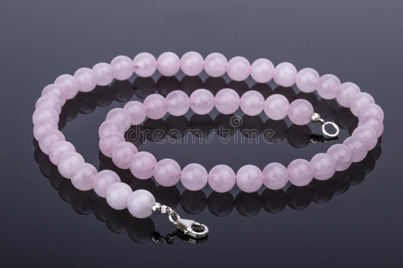 Beautiful and luxury Pink Quartz pearl necklace on a reflective stock images