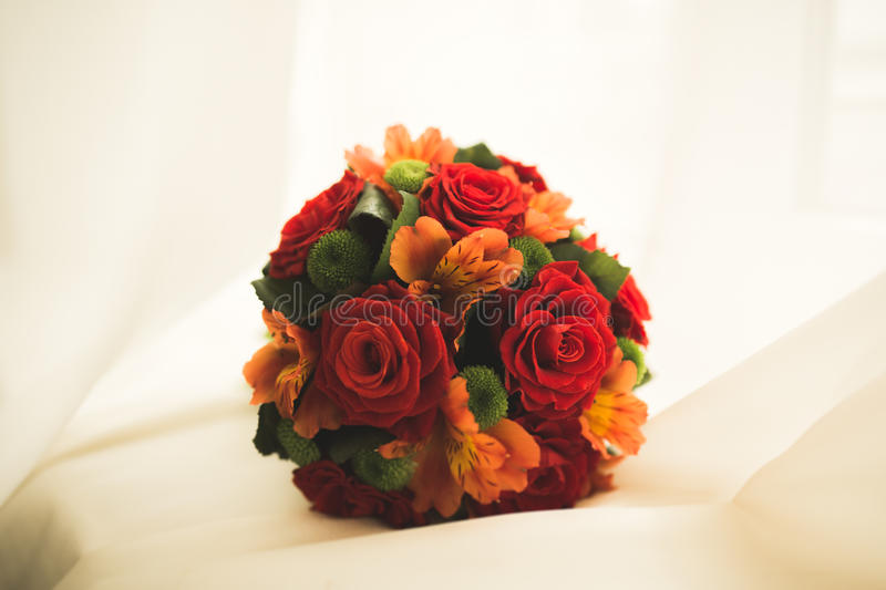 Beautiful luxury wedding bouquet of red flowers. Beautiful luxury wedding bouquet of different flowers royalty free stock photography